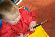 Baby in Painting Tiny Tots Room at Wombles Crèche
